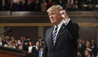 President Donald Trump gestures as he arrives on Capitol Hill in Washington, Tuesday, Feb. 28, 2017, for his address to a joint session of Congress. (Jim Lo Scalzo/Pool Image via AP)