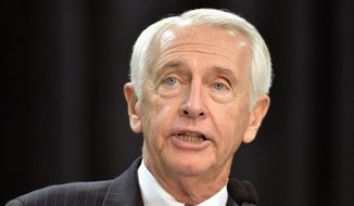 "In this Dec. 1, 2015, file photo, then-Kentucky Governor Steve Beshear speaks in Louisville, Ky. Beshear took a populist tenor in Democrats' formal response to President Donald Trump's speech to Congress on Tuesday, Feb. 28, 2017, accusing him of planning to ""rip affordable health insurance"" from Americans and being ""Wall Street's champion."" Seated at a diner in Lexington, Ky., Beshear assailed Trump for ""ignoring serious threats to our national security from Russia, who's not our friend, while alienating our allies."" (AP Photo/Timothy D. Easley, File)"