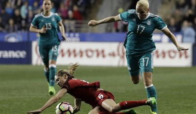 Germany's Isabel Kerschowski (17) tries to get around United States' Morgan Brian (6) during the first half of a SheBelieves Cup women's soccer match, Wednesday, March 1, 2017, in Chester, Pa. (AP Photo/Matt Slocum)