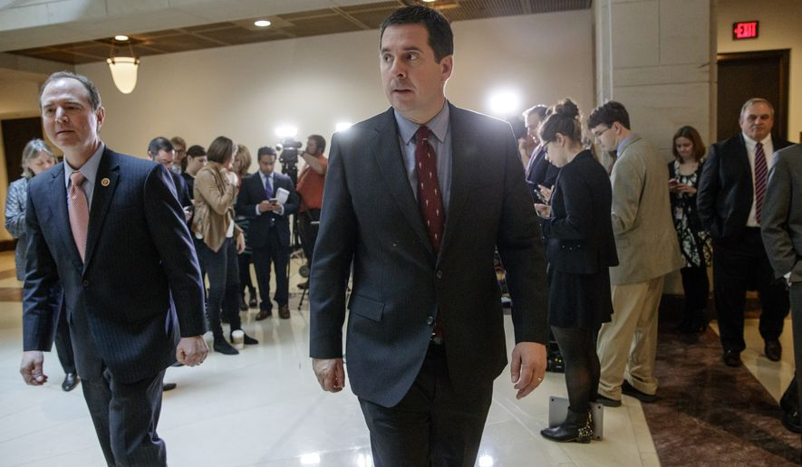 House Intelligence Committee Chairman Rep. Devin Nunes, R-Calif., right, and the committee's ranking member Rep. Adam Schiff, D-Calif., leave after talking to reporters on Capitol Hill in Washington, Thursday, March 2, 2017, following a briefing with FBI Director Jim Comey about Russian influence on the American presidential election.  (AP Photo/J. Scott Applewhite)