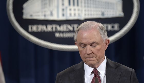 Attorney General Jeff Sessions pauses during a news conference at the Justice Department in Washington, Thursday, March 2, 2017. Sessions said he will recuse himself from a federal investigation into Russian interference in the 2016 White House election. (AP Photo/Susan Walsh)