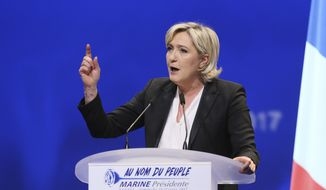 In this Sunday, Feb. 26, 2017, file photo, French Far-right leader presidential candidate Marine Le Pen gestures as she speaks during a conference in Nantes, western France. The European Parliament voted Thursday, March 2, to lift French far-right leader Marine Le Pen's immunity from prosecution for tweeting gruesome images of violence, a crime carrying a maximum sentence of three years in prison. (AP Photo/David Vincent, file)