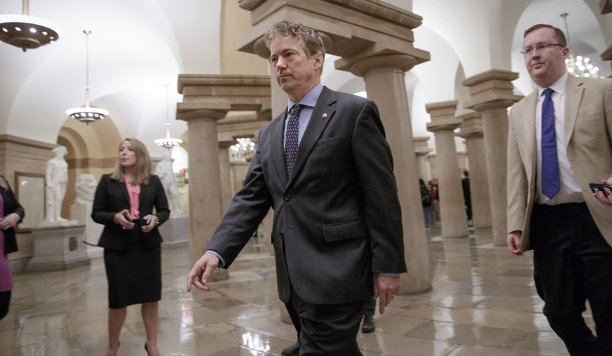 Sen. Rand Paul, R-Ky., a member of the Senate Health, Education, Labor, and Pensions Committee, walks to a room on Capitol Hill in Washington, Thursday, March 2, 2017. (AP Photo/J. Scott Applewhite) ** FILE **