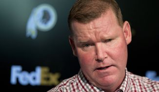 """FILE - In this April 25, 2016, file photo, Washington Redskins' general manager Scot McCloughan speaks during a news conference at Redskins Park in Ashburn, Va. McCloughan is not attending the NFL combine in Indianapolis. Team spokesman Tony Wyllie confirmed McCloughan's absence in an email to The Associated Press Thursday, March 2, 2017, saying McCloughan """"is taking care of some family matters."""" (AP Photo/Manuel Balce Ceneta, File)"""