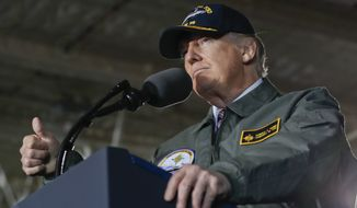 President Donald Trump gives a thumbs up while speaking to Navy and shipyard personnel aboard nuclear aircraft carrier Gerald R. Ford, Thursday, March 2, 2017, at Newport News Shipbuilding in Newport News, Va. The ship which is still under construction is due to be delivered to the Navy later this year. (AP Photo/Pablo Martinez Monsivais)