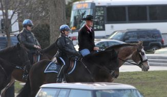 In this photo provided by the Interior Department shows Interior Secretary Ryan Zinke arriving for his first day of work at the Interior Department in Washington, Thursday, March 2, 2017, aboard Tonto, an 17-year-old Irish sport horse.  (Interior Department via AP)