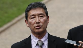 Ri Tong-il, former North Korean deputy ambassador to the United Nations, speaks to journalist outside the North Korean embassy in Kuala Lumpur, Malaysia on Thursday, March 2, 2017. The North Korean envoy said a heart attack likely killed Kim Jong-nam, not VX nerve agent as a Malaysia autopsy showed, regarding the investigation into the assassination of Kim, the estranged half brother of North Korea's leader Kim Jong-un. (AP Photo/Vincent Thian)