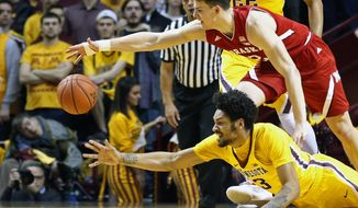 Nebraska's Michael Jacobson, top, and Minnesota's Jordan Murphy chase the loose ball during the first half of an NCAA college basketball game Thursday, March 2, 2017, in Minneapolis. (AP Photo/Jim Mone)