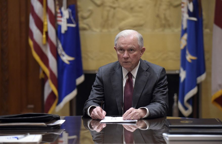 FILE - In this Feb. 9, 2017, file photo, Attorney General Jeff Sessions holds a meeting with the heads of federal law enforcement components at the Department of Justice in Washington. Sessions had two conversations with the Russian ambassador to the United States during the presidential campaign season last year, contact that immediately fueled calls for him to recuse himself from a Justice Department investigation into Russian interference in the election. The Justice Department said Wednesday night, March 1, 2017, that the two conversations took place last year when Sessions was a senator. (AP Photo/Susan Walsh, Pool, File)