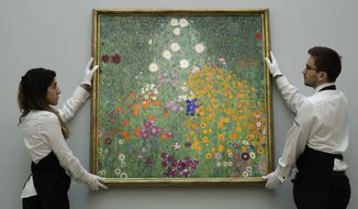 "FILE - This is a Wednesday, Feb. 22, 2017, file photo of Sotheby's auction house staff as they pose for photographers with Austrian artist Gustav Klimt's ""Bauerngarten (Blumengarten)"" during a photocall at their premises in London. The exuberant floral landscape by Gustav Klimt has sold at auction for almost 48 million pounds _ the third-highest price ever paid for an artwork in Europe. ""Bauerngarten (Flower Garden)"" went under the hammer for 47.9 million ($59.3 million) at Sotheby's in London. Sotheby's Europe chairwoman Helena Newman said the painting was ""one of the artist's greatest masterpieces ever to come to auction."" (AP Photo/Matt Dunham, File)"