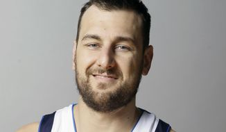 FILE - In this Sept. 26, 2016, file photo, Dallas Mavericks center Andrew Bogut smiles during an NBA basketball media day in Dallas. Bogut is officially chasing a championship with the Cavaliers. The free agent center signed with Cleveland on Thursday, March 2, 2017, joining the team he faced in the NBA Finals the past two seasons when he was with Golden State. A former No. 1 overall pick, Bogut is not expected to make his debut with Cleveland until next Monday when the Cavs host Miami.(AP Photo/LM Otero, File)
