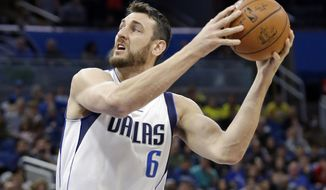 FILE - In this Nov. 19, 2016, file photo, Dallas Mavericks' Andrew Bogut (6) looks for a shot against the Orlando Magic during the first half of an NBA basketball game, in Orlando, Fla. The free agent center officially signed with the Cleveland Cavaliers on Thursday, March 2, 2017, joining the team he faced in the NBA Finals the past two seasons when he was with Golden State. A former No. 1 overall pick, Bogut is not expected to make his debut with Cleveland until next Monday when the Cavs host Miami.(AP Photo/John Raoux, File)