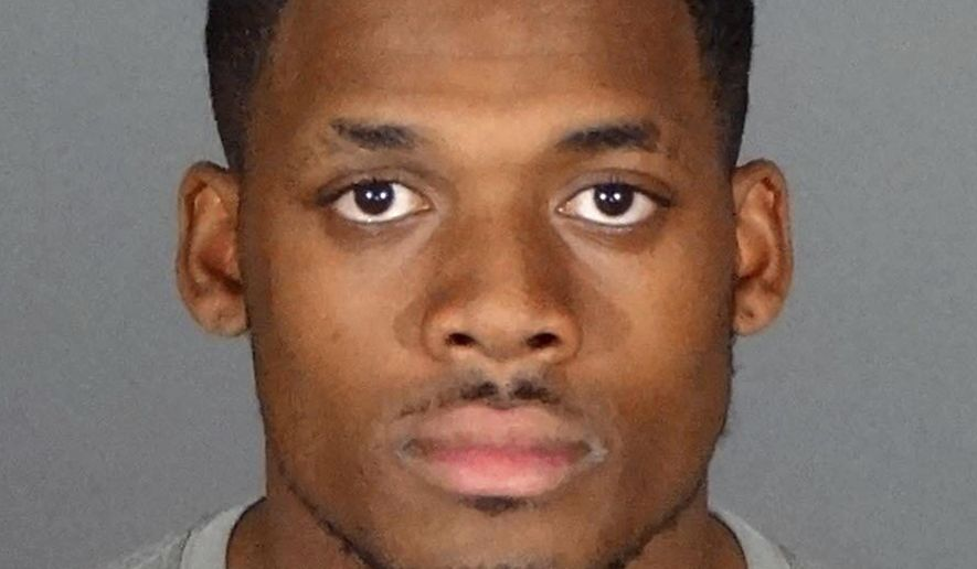 This undated booking photo provided by the Los Angeles County Sheriff's Department shows Kishawn Holmes. Los Angeles Sheriff's Det. Sgt. Marvin Jaramilla said Thursday, March 2, 2017, that Holmes, a Cerritos College football player once convicted of sexual assault as a teenager, has been arrested on suspicion of raping his physical therapist. Jaramilla said Holmes is suspected of sexually assaulting the 19-year-old victim, a fellow Cerritos student. (Los Angeles County Sheriff's Department via AP)