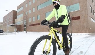 FOR RELEASE MONDAY, MARCH 6, 2017, AT 12:01 A.M. CST.- Tim Candahl, La Crosse County medical examiner, regularly commutes to and from work by bicycle. Candahl, leads the La Crosse Area Planning Committee, rides his bike from the far Southside to downtown most days.(Rory O' Driscoll/La Crosse Tribune via AP)