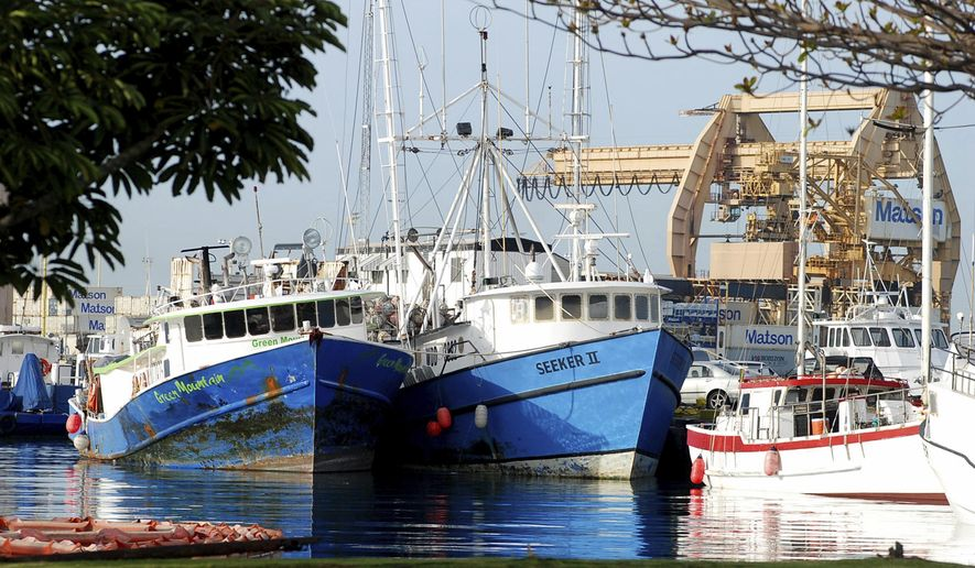 FILE - This Feb. 2, 2017 file photo shows commercial fishing boats docked at Pier 38 in Honolulu. Another Hawaii bill that sought more oversight of the state's commercial fishing industry is dying. The bill would have required boat operators to provide contracts between foreign fishermen and employers. (AP Photo/Caleb Jones, File)