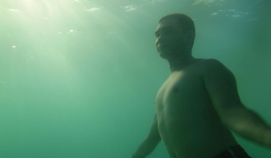 "This image released by the Tribeca Film Festival shows Elian Gonzalez swimming in the Cuban sea in a scene from the Alex Gibney-produced documentary ""Elian,"" which will premiere at the Tribeca Film Festival. (Ross McDonnell/Tribeca Film Festival via AP)"