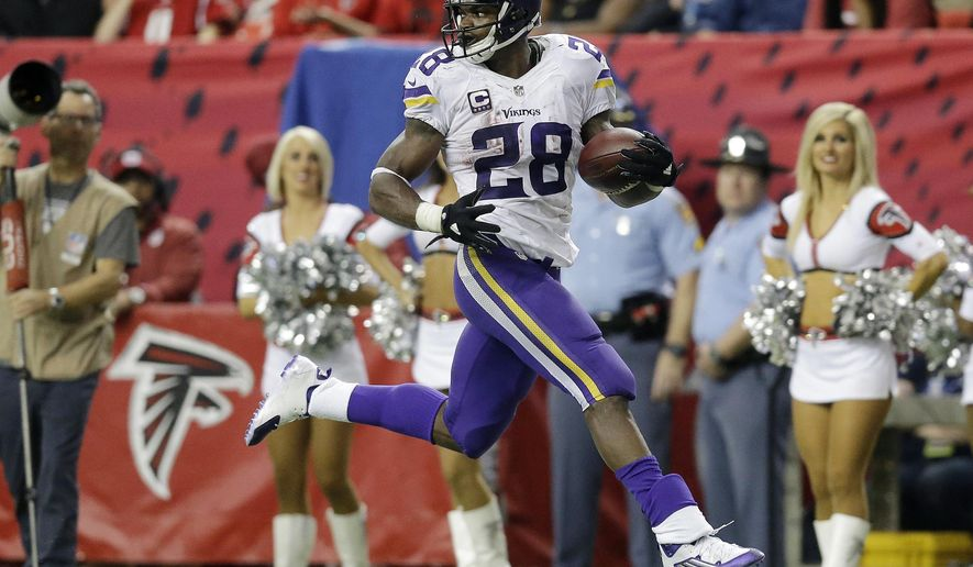 FILE - In this Nov. 29, 2015, file photo, Minnesota Vikings running back Adrian Peterson (28) runs for a touchdown against the Atlanta Falcons during the second half of an NFL football game in Atlanta. Adrian Peterson and Jamaal Charles, both stalwarts for their previous clubs and with All-Pro credentials, are out there. But how many 30-plus running backs get long-term deals, even proven ones such as these? And both will want big bucks.  (AP Photo/David Goldman, File)