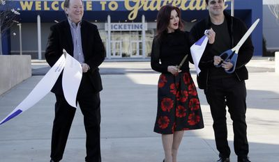 "Priscilla Presley, center, cuts the ribbon with Jack Soden, left, Elvis Presley Enterprises president, and Joel Weinshanker, Graceland Holdings managing partner, during the grand opening of the ""Elvis Presley's Memphis"" complex Thursday, March 2, 2017, in Memphis, Tenn. The $45 million entertainment complex, located across the street from Graceland, Presley's longtime home, features exhibits and restaurants focused on his life and career. (AP Photo/Mark Humphrey)"