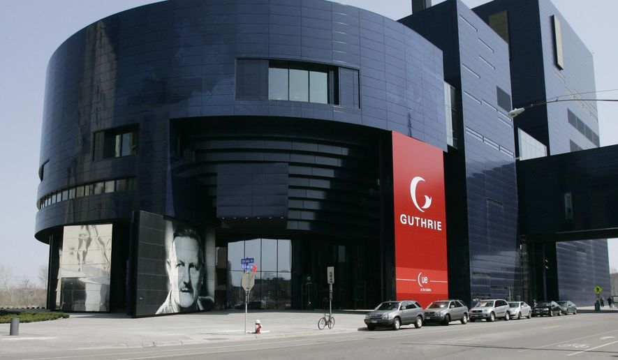 FILE - In a April 20, 2007 file photo, a portrait of Sir Tyrone Guthrie, lower left, graces the front of the new Guthrie Theater, in Minneapolis. The Minneapolis theater announced seven of its upcoming nine productions Thursday, March 2, 2017. The Guthrie Theater's new season will explore contemporary issues such as race relations and cultural assimilation.  (AP Photo/Jim Mone, File)