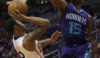 Charlotte Hornets guard Kemba Walker (15) pressures Phoenix Suns guard Tyler Ulis in the third quarter during an NBA basketball game, Thursday, March 2, 2017, in Phoenix. Phoenix defeated Charlotte 120-103. (AP Photo/Rick Scuteri)