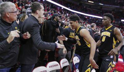 Iowa's Cordell Pemsl (35) and Tyler Cook (5) celebrate the team's 59-57 win over Wisconsin in an NCAA college basketball game Thursday, March 2, 2017, in Madison, Wis. (AP Photo/Andy Manis)