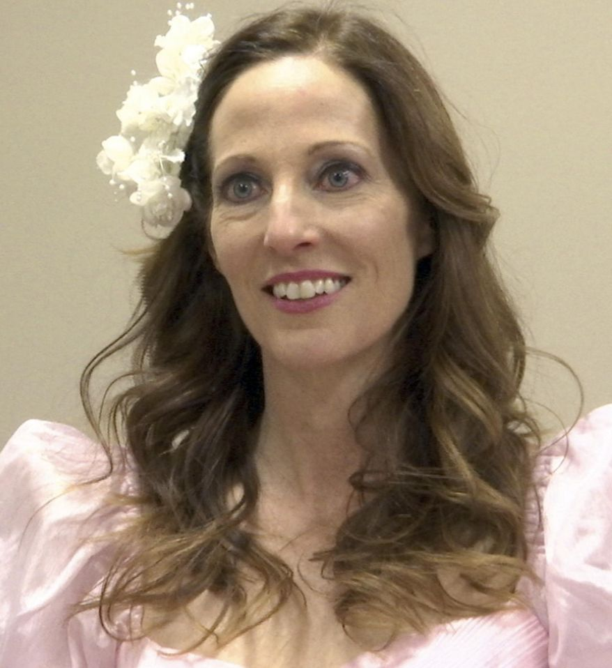 In this Feb. 25, 2017 image made from video, Betsy Crapps is interviewed before the Mom Prom at St. Thomas a'Becket Catholic Church in Canton Township, Mich. Crapps is the founder of Mom Prom, an annual event at which women don their old prom, bridesmaid or wedding dresses and gather in the church's gym for a night of dancing, drinking and togetherness, with proceeds going to charity. (AP Photo/Mike Householder)