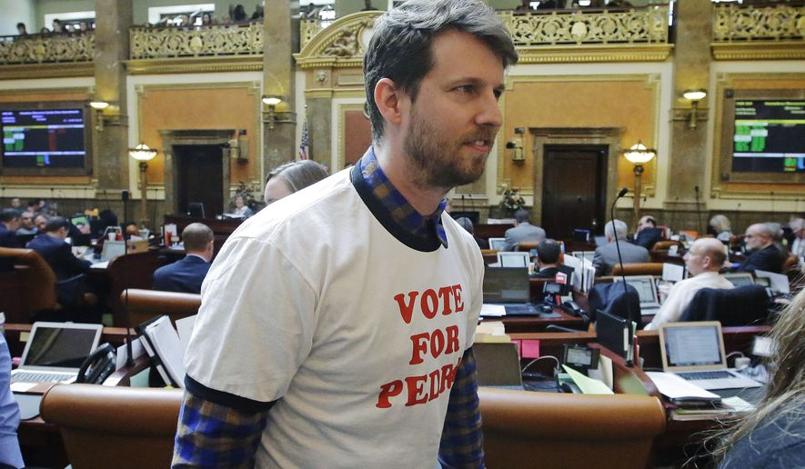"Actor and producer Jon Heder leaves the Utah House floor after speaking with the representatives at the Utah State Capitol Thursday, March 2, 2017, in Salt Lake City. The star of 2004 hit movie ""Napoleon Dynamite"" is telling lawmakers that Utah's film tax incentives are vital to luring productions to the state. Heder spoke briefly to the state's legislature on Thursday about how the tax credits could help him bring movies to Utah. He wore a ""Vote For Pedro"" T-shirt in a nod to a memorable shirt worn by Heder in the film. (AP Photo/Rick Bowmer)"
