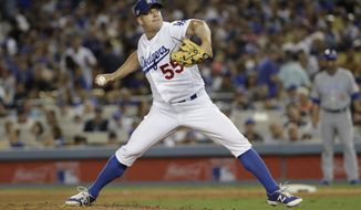 FILE - In this Oct. 20, 2016 file photo, Los Angeles Dodgers relief pitcher Joe Blanton pitches during the sixth inning of Game 5 of the National League baseball championship series against the Chicago Cubs, in Los Angeles. A person with knowledge of the deal tells The Associated Press that Blanton and the Washington Nationals have agreed to a $4 million, one-year contract. The person spoke to the AP on condition of anonymity on Tuesday, Feb. 28, 2017, because nothing had been announced. (AP Photo/David J. Phillip, File)
