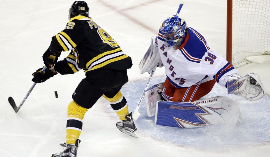Boston Bruins right wing David Pastrnak (88) shoots the puck but can't score against New York Rangers goalie Henrik Lundqvist (30) during the first period of an NHL hockey game, Thursday, March 2, 2017, in Boston. (AP Photo/Elise Amendola)