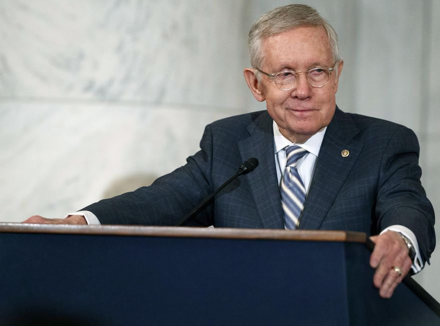 FILE - In this Dec. 8, 2016 file photo Sen. Harry Reid, D-Nev., speaks during a ceremony on Capitol Hill in Washington. Reid and John Boehner are going to co-chair a new public policy think tank at the University of Nevada, Las Vegas. MGM Resorts International and UNLV plan to bring plans for the institute headed by the retired U.S. Senate Democratic majority leader from Nevada and the former House Republican speaker from Ohio before Nevada university regents on Thursday, March 2, 2017.  (AP Photo/Evan Vucci, File)