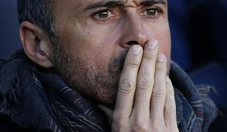 FILE - In this Jan. 14, 2017 file photo, FC Barcelona coach Luis Enrique looks out from the bench prior to the Spanish La Liga soccer match between FC Barcelona and Las Palmas at the Camp Nou in Barcelona, Spain. Barcelona coach Luis Enrique will leave the Spanish champions at the end of this season. The coach made the surprise announcement following the team's 6-1 win over Sporting Gijon in the Spanish league on Wednesday March 1, 2017. (AP Photo/Manu Fernandez, File)