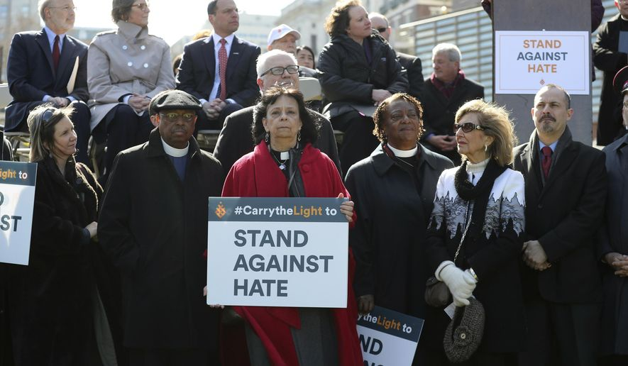 Rev. Ruth Santana-Grace, center,  stands with other religious leaders as the Jewish Federation holds a 'Stand Against Hate' rally at Independence Hall, to protest the recent vandalism of Jewish cemeteries as well as hate crimes, Thursday, March 2, 2017, in Philadelphia. (David Swanson /The Philadelphia Inquirer via AP)