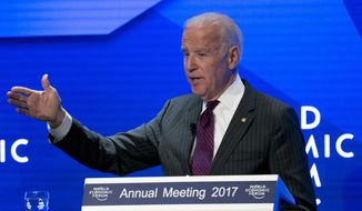 FILE - In this Jan. 16, 2017 file photo, U.S. Vice President Joe Biden speaks during an event prior to the World Economic Forum in Davos, Switzerland. Biden defended the courts and the news media, saying attacks against those institutions are dangerous. He was speaking Wednesday, March 1, at the Newseum in Washington, where he accepted an award from the Bipartistan Policy Center. (AP Photo/Michel Euler)