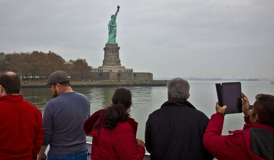 "FILE - In this Nov. 5, 2015, file photo, visitors view the Statue of Liberty during a ferry ride to Liberty Island in New York. The U.S. Travel Association on Thursday, March 2, 2017, said there are ""mounting signs"" that the Trump administration's policies are having a ""broad chilling effect on demand for international travel to the United States."" (AP Photo/Bebeto Matthews, File)"