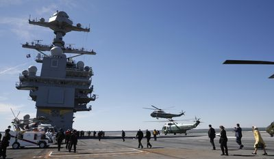 Marine One, with President Donald Trump aboard, lands on nuclear aircraft carrier Gerald R. Ford, at Newport News Shipbuilding in Newport, Va., Thursday, March 2, 2017. Trump traveled to Virginia to meet with sailors and shipbuilders on aircraft carrier which is scheduled to be commissioned this year after cost overruns and delays. (AP Photo/Pablo Martinez Monsivais)