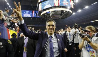"FILE - In this April 4, 2016, file photo, Villanova head coach Jay Wright celebrates after the NCAA Final Four tournament college basketball championship game against North Carolina, in Houston. Jay Wright recounts Villanova's national championship run in his new book, ""Attitude.""  (AP Photo/David J. Phillip, File)"