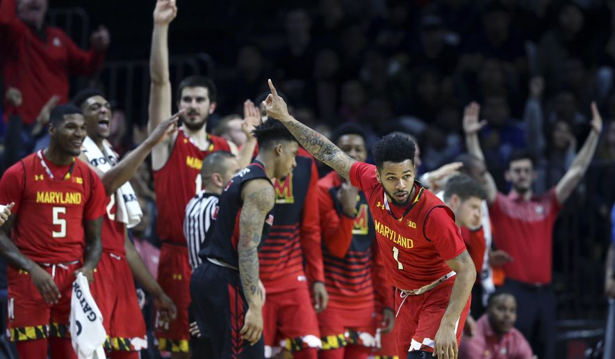 Maryland guard Jaylen Brantley (1) and his teammates react after he made a basket during the second half of the team's NCAA college basketball game against Rutgers on Tuesday, Feb. 28, 2017, in Piscataway, N.J. Maryland won 79-59. (AP Photo/Mel Evans)