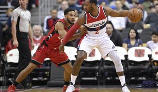 Washington Wizards guard John Wall (2) dribbles next to Toronto Raptors guard Cory Joseph (6) during the first half of an NBA basketball game, Friday, March 3, 2017, in Washington. (AP Photo/Nick Wass)