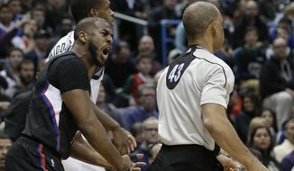 Los Angeles Lakers' Chris Paul, left, argues a call with referee Danny Crawford (43) during the first half of the team's NBA basketball game against the Milwaukee Bucks on Friday, March 3, 2017, in Milwaukee. (AP Photo/Jeffrey Phelps)