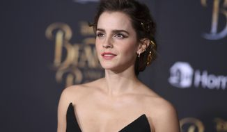 "Emma Watson arrives at the world premiere of ""Beauty and the Beast"" at the El Capitan Theatre on Thursday, March 2, 2017, in Los Angeles. (Photo by Jordan Strauss/Invision/AP)"