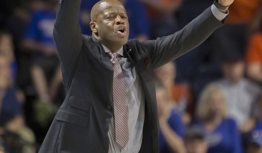 Arkansasp coach Mike Anderson signals to his team during the second half of an NCAA college basketball game against Florida in Gainesville, Fla., Wednesday, March 1, 2017. Florida won 78-65. (AP Photo/Ron Irby)