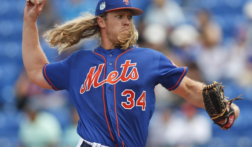 New York Mets starting pitcher Noah Syndergaard (34) delivers in the first inning of a spring training baseball game against the Houston Astros, Friday, March 3, 2017, in Port St. Lucie, Fla. (AP Photo/John Bazemore)