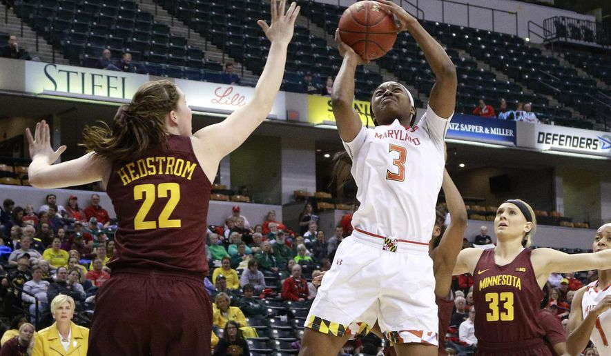 Maryland guard Kaila Charles (3) shoots between Minnesota guards Joanna Hedstrom (22) and Carlie Wagner (33) during the first half of an NCAA college basketball game in the quarterfinals of the Big 10 conference tournament, Friday, March 3, 2017, in Indianapolis. (AP Photo/R Brent Smith)