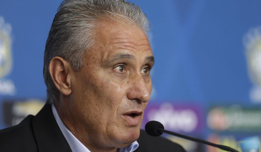Brazil soccer coach Tite announces the names of players who will play in the upcoming World Cup 2018 qualifying matches against Uruguay and Paraguay, during a press conference in Sao Paulo, Brazil, Friday, March 3, 2017. (AP Photo/Andre Penner)