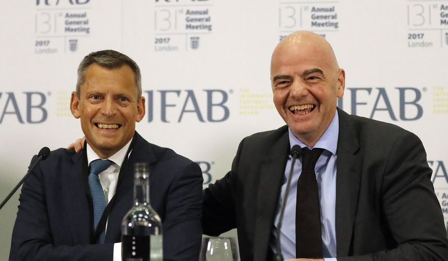 Football Association , FA, CEO Martin Glenn, left, and FIFA President Gianni Infantino smile during a press conference after the 131st International Football Association Board (IFAB) annual general meeting at Wembley stadium in London, Friday, March 3, 2017. (AP Photo/Frank Augstein)