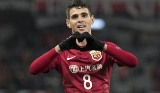 In this Feb. 28, 2017 photo, Brazilian player Oscar of Shanghai SIPG makes a gesture during an Asian Champions League group-stage match against Western Sydney Wanderers in Shanghai, China. For a second successive winter transfer window, the Chinese Super League has upset the established world soccer order with the spending power and ambition of its biggest clubs. It started in December as Shanghai SIPG agreed to pay $60 million to Chelsea for Brazil's Oscar in a move that prompted Antonio Conte, coach of the Premier League club, to warn about the challenge from the east. (Chinatopix Via AP)