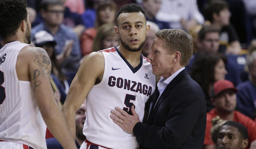 FILe - In this Dec. 29, 2016, file photo, Gonzaga head coach Mark Few, right, speaks with guard Nigel Williams-Goss (5) as Williams-Goss goes to the bench during the second half of an NCAA college basketball game against Pepperdine, in Spokane, Wash. No matter what the Zags seem to do, Gonzaga coach Mark Few and his team never quite seem to get the respect they deserve. (AP Photo/Young Kwak, File)