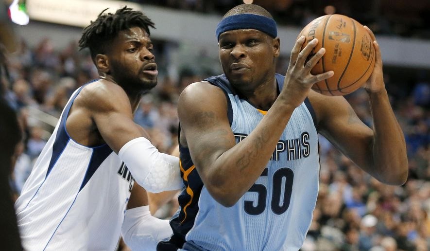 Dallas Mavericks' Nerlens Noel (3) defends as Memphis Grizzlies' Zach Randolph (50) positions for a shot during the first half of an NBA basketball game in Dallas, Friday, March 3, 2017. (AP Photo/Tony Gutierrez)