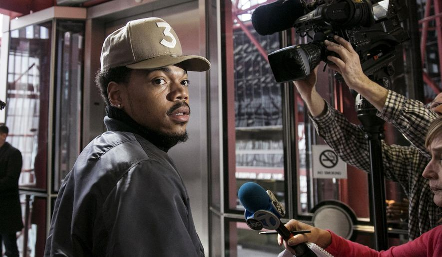 Grammy-winning artist Chance the Rapper meets with reporters at the Thompson Center in Chicago after a meeting with Illinois Gov. Bruce Rauner on Friday, March 3, 2017. (Ashlee Rezin/Chicago Sun-Times via AP)