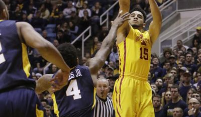 Iowa State guard Nazareth Mitrou-Long (15) shoots a 3-pointer over West Virginia guard Daxter Miles Jr. (4) during the first half of an NCAA college basketball game, Friday, March 3, 2017, in Morgantown, W.Va. (AP Photo/Raymond Thompson)
